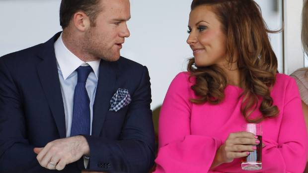 Wayne Rooney with his wife Coleen.