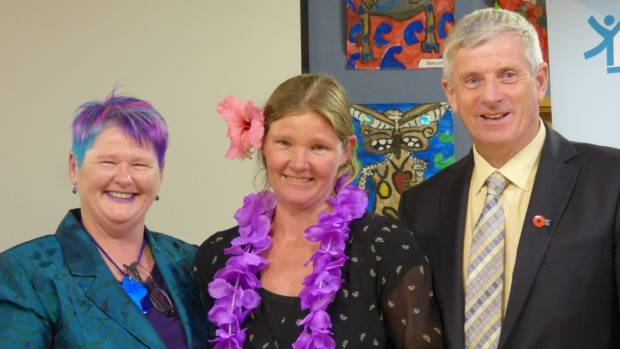 Verity Shuttleworth, centre, with tutor Angela Coleman and Rangitikei mayor Andy Watson.