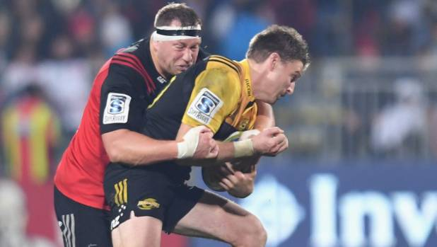 Crusaders prop Wyatt Crockett wraps up Hurricanes first-five Beauden Barrett during the teams' clash in Christchurch.