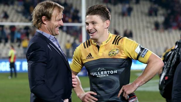 Crusaders coach Scott Robertson and Hurricanes first-five Beauden Barrett laugh together after the match in Christchurch.