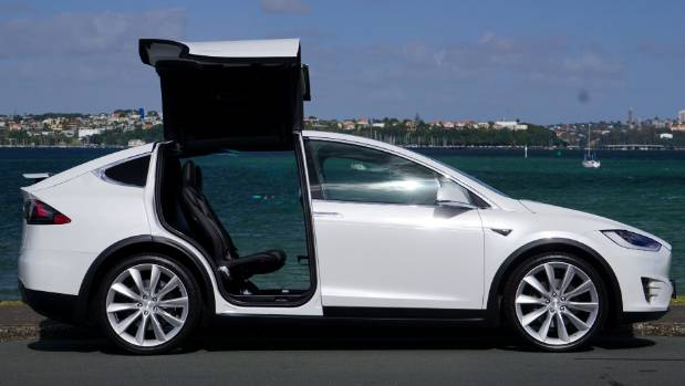 Tesla Model X has Falcon doors at the rear. A dollar if you can jump right through without touching anything.
