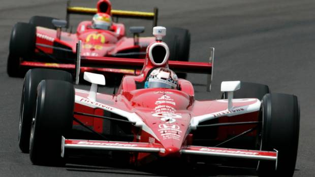 Dixon drives through turn one ahead of Justin Wilson, of England, on the Kiwi's way to victory during the 92nd running ...
