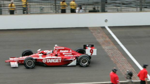 Dixon crosses the finish line of the Indianapolis 500 in 2008.