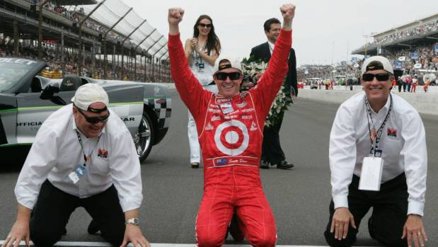 Scott Dixon, centre, celebrates on the start-finish line with car owner Chip Ganassi, left, and Gregg Steinhafel, ...