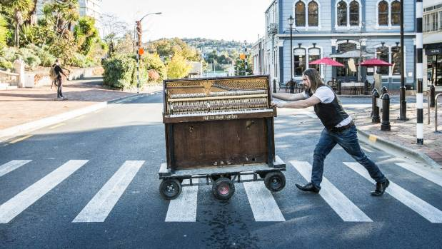 The piano is mounted on a wheeled platform and designed to perfectly fit in the back of his Land Rover.
