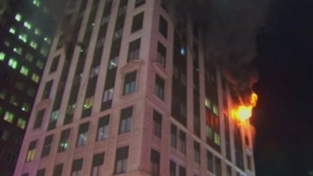 "Fire experts say ""stay put"" is still the best advice in high-rise building fires - as long as the building has proper ..."