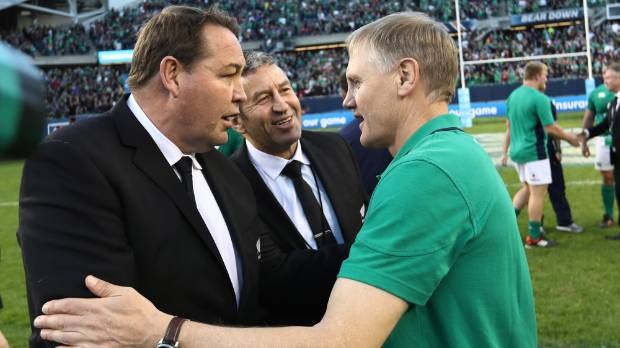 All Blacks head coach Steve Hansen and adviser Wayne Smith congratulate Ireland's Kiwi coach Joe Schmidt after Ireland's ...