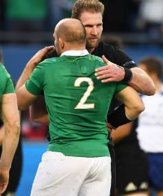 Kieran Read and Ireland captain Rory Best embrace after Ireland's win in Chicago.