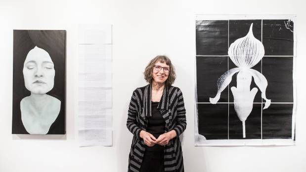 Curator Catharine Salmon with work from the exhibition TLC