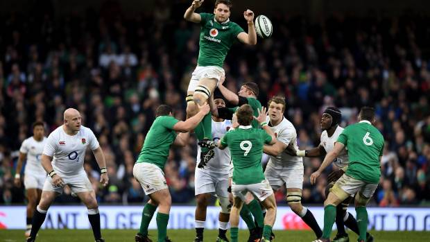 Iain Henderson of Ireland soars high to win a lineout against England.