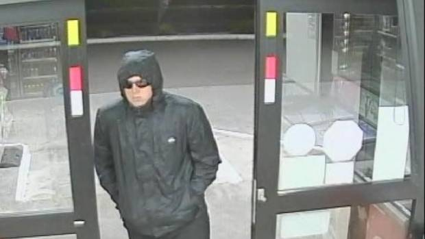 Police have released a CCTV image of a man they say robbed a service station on May 15.