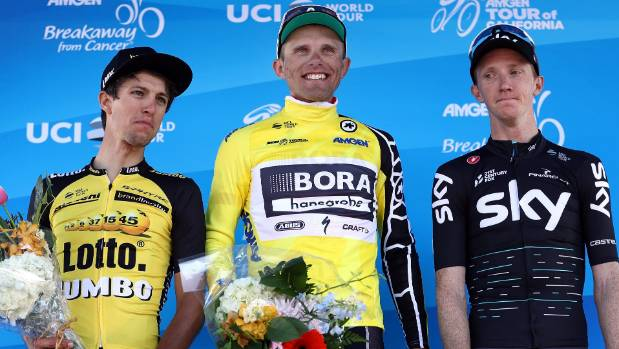 From left, George Bennett , Rafal Majka and Ian Boswell stand on the podium after stage two.