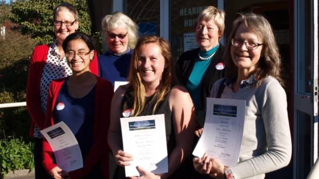 Jo Dippie, back left, of Page &  Blackmore with short story prize winners Febriani Idrus, Jackie Cook, Reade Moore, ...