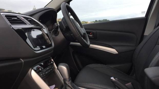 Interior is highly specified, including leather upholstery.