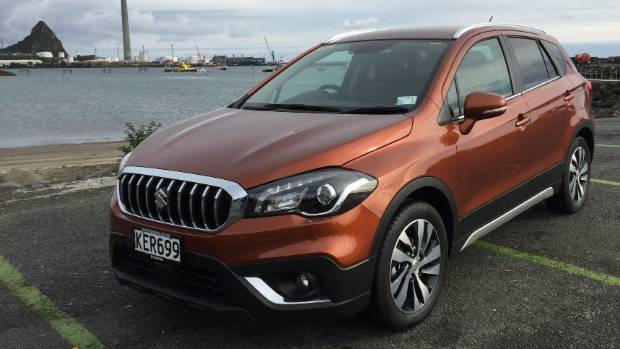 The facelifted Suzuki S-Cross with its toothy new grille.
