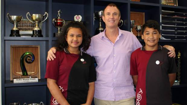 Ella Diaz, Principal Iain Taylor and Kalepo Solomona.