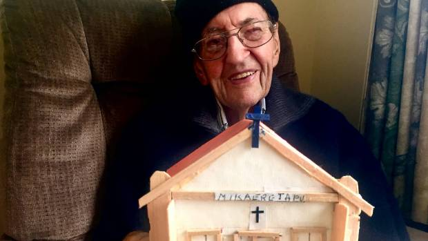 Doug Edmiston with a model that he made of St Michael's Church in Highbury, Palmerston North.