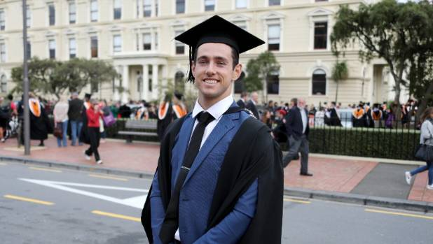 Paralympian gold medal winner Liam Malone in the graduation march on Tuesday.
