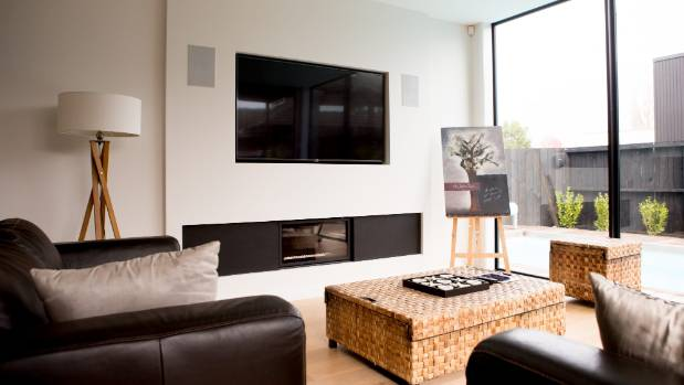 "There is a gas fire beneath the TV in the lounge, a west-facing ""sun trap"", according to builder Nick Holcroft, who won ..."