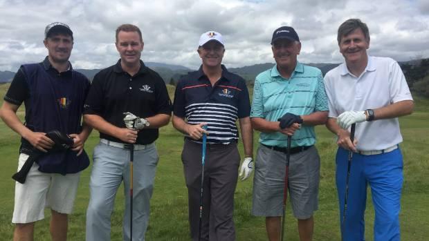 Caddy Brett Smith, Paraparaumu Beach Golf Club general manager Leo Barber, Prime Minister John Key, club president Paul ...