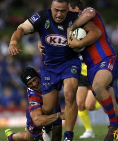 Sam Kasiano on the charge against the Knights.