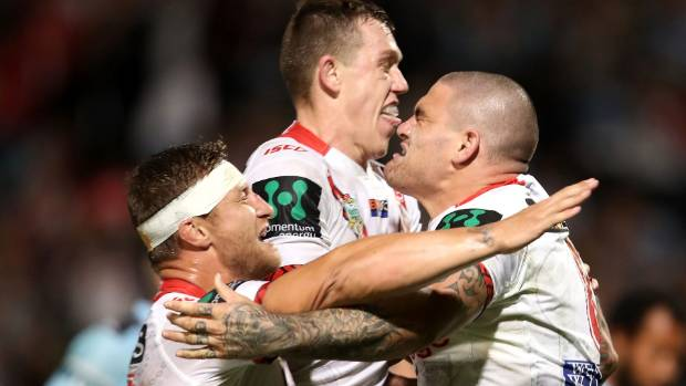 Russell Packer (R) celebrates with team-mates after scoring a try for the Dragons. He is leaving them to join Wests ...