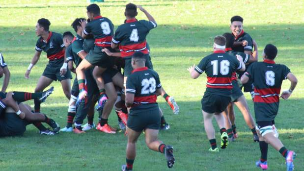 Dilworth's First XV celebrate a historic 20-15 win over high school rugby powerhouse Mount Albert Grammar.