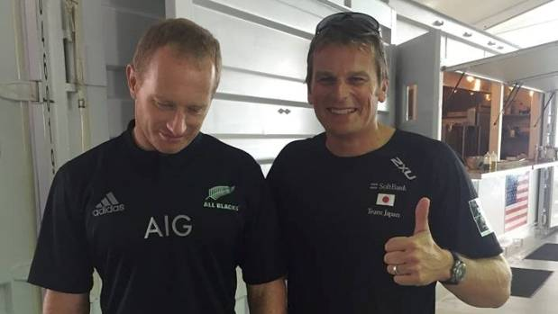 Dean Barker can't hide his delight as Australian Jimmy Spithill is forced to don an All Blacks jersey over a 2015 Rugby ...