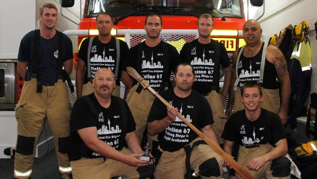 The Kerikeri Fire Brigade's Sky Tower Stair Challenge Team with the community spirit award trophy and taiaha.