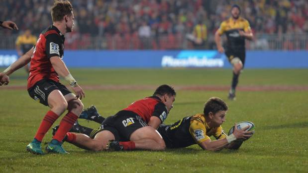 Beauden Barrett is tackled by Codie Taylor.