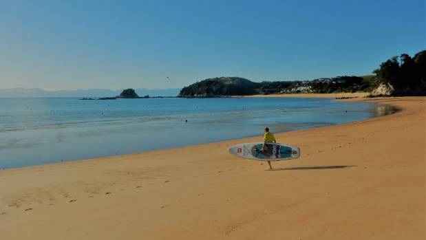 Kaiteriteri Beach, Nelson region.  Lyndon and I had the beach to ourselves as we strolled across the beach to launch our ...