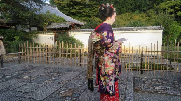 "A late afternoon stroll through ""Gion"" in Kyoto, Japan, I came across this Geisha in contemplative repose. Defined by ..."
