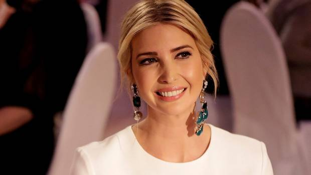 Ivanka wearing the mismatched statement earring trend.