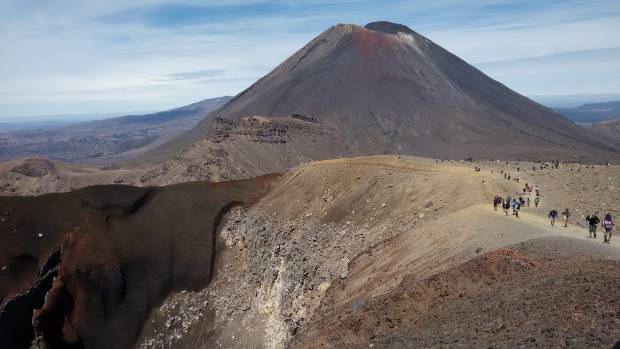 A clear hot day on the Tongariro Crossing, at almost 1800 metres, standing by the gaping Red Crater, looking back at Mt ...