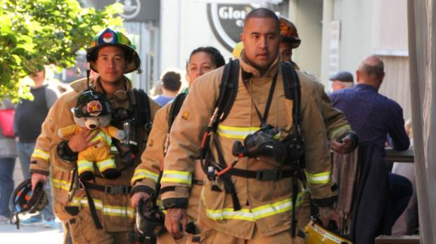 Aaron Nepia leads the Kaikohe firefighters to the start of the Sky Tower Stair Climb.
