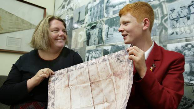 Dee Uren-Perry, left, with her son Stephen Potter, of Invercargill, after receiving a replica copy of the handkerchief ...