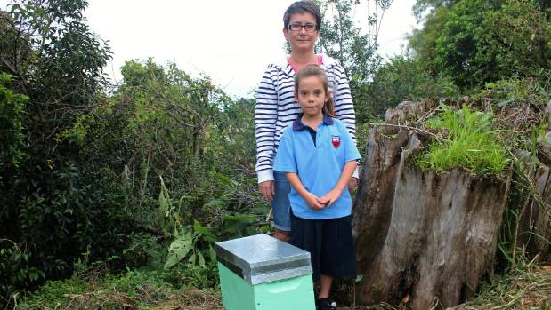 Claire Naylor, with daughter Zoey Myers, 7, are disappointed to have lost a whole colony of bees after only a few months.