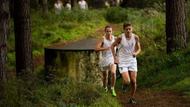 Senior boys winner Alex Hull, right, and second-placed Harrison Porritt trek through the forest during the Manawatu ...