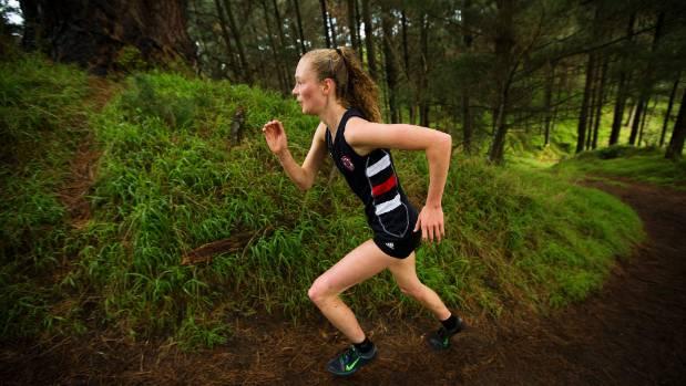 Feilding High School's Tessa Webb powers up a hill on her way to winning the senior girls title at Manawatu College on ...
