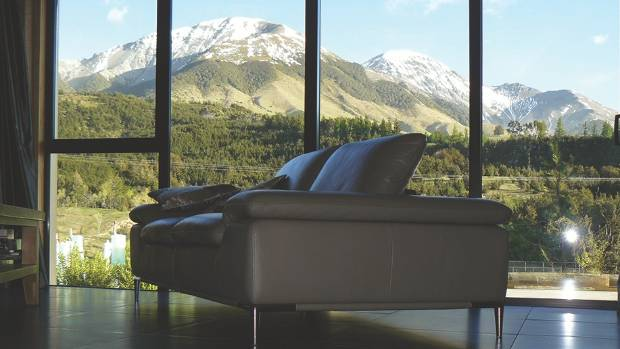 An open-plan living area is perfect for relaxing and enjoying the mountain views.
