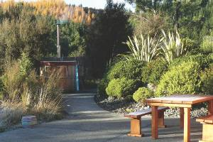 The eco lodge has a secluded outdoor dining area and a hot tub.