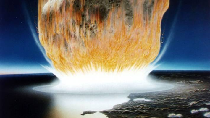 This artist's conception shows an asteroid crashing into Earth in an event that scientists believe occurred in the Caribbean region at the boundary of the Cretaceous and Tertiary periods in Earth's geologic history about 65 million years ago causing the extinction of dinosaurs.