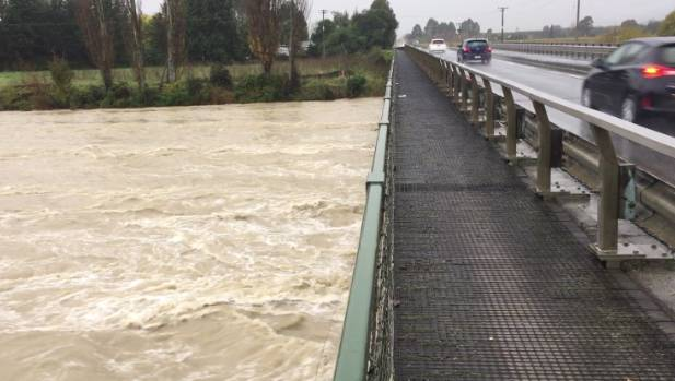 Rain swells the Wairoa River at the Brightwater Bridge.