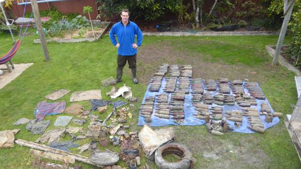 Stew Robertson with some of the rubbish collected from around Adele Island and Anchorage.
