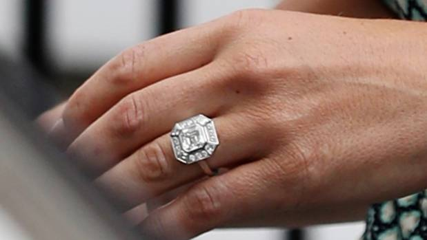 According to experts, Pippa's three-carat art deco-style engagement ring is an estimated $350,000.