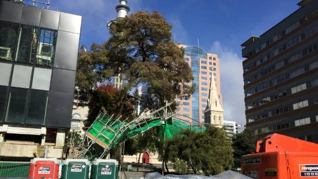 A wall of scaffolding collapsed across Federal Square in central Auckland, near the Sky Tower and St Patrick's ...