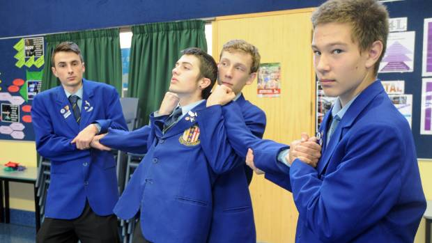 The boys from the St Bernard's College O'Shea Shield drama team re-enact a scene from their performance.  From left: ...