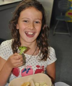 It is broccoli time for 10 year-old Josee Procter.