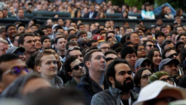 Attendees watch on at the opening keynote during the annual Google I/O developers conference in San Jose, California.