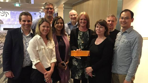 Angela Rowan holds an orange award presented to a Fonterra team for research into paediatric nutrition at last year's ...